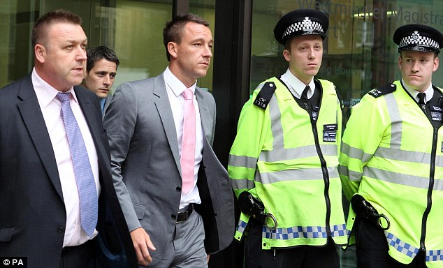 End of day one: Terry, seen leaving court, is accused of racially abusing Ferdinand