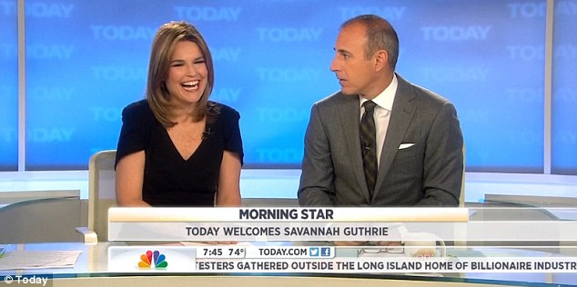 Happy to be there: Matt Lauer officially welcomes Savannah Guthrie as his co-host this morning, saying she had a 'weird sense of humor'