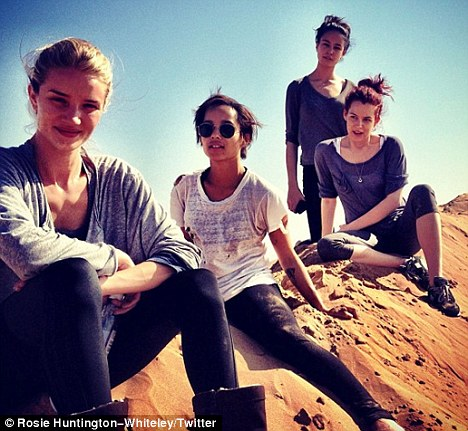 In action: Rosie tweeted a picture of herself on the Mad Max set alongside Zoe Kravitz