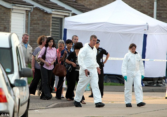 Police lead residents through the scene near Redbridge Road, Clacton, where PC Ian Dibell was shot dead