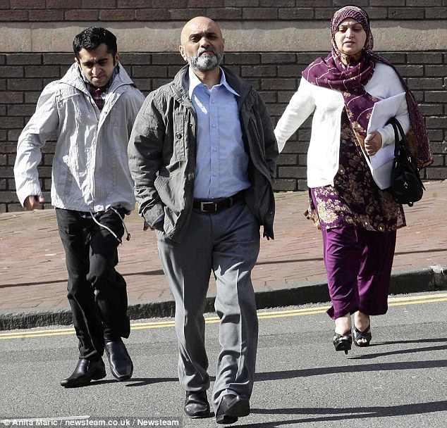 Mohammed Mumtaz, left, Salma Aslam, right, and Zia Ul-Haq, centre, arrive at Birmingham Crown Court