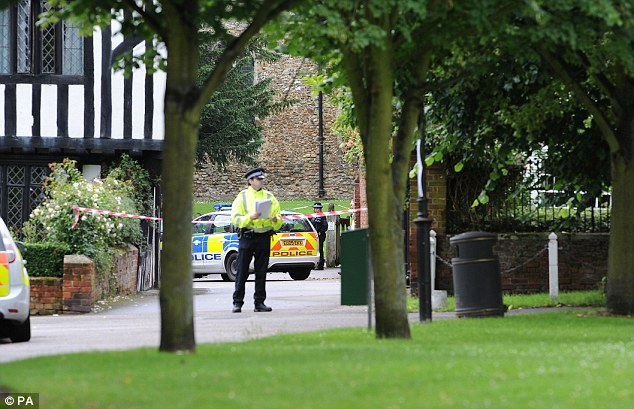 On guard: Police at the scene outside the church in Writtle. It is believed Reeve had a 'strong connection' to the village