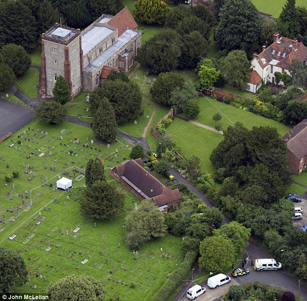 Macabre end: A white forensics tent has been erected among the gravestones in All Saints Church graveyard in Writtle, Essex, where the body of gunman Peter Reeve was found this morning