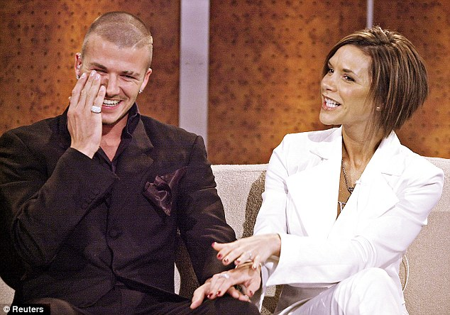 October 2001: David is not the only person who finds it funny when his wife tries her best to look normal. Many women would look more ecstatic to be Mrs Beckham