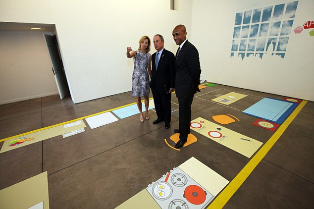 Mayor Michael Bloomberg, center, inspects the kitchenette area of full-scale mockup of a 300 square foot apartment