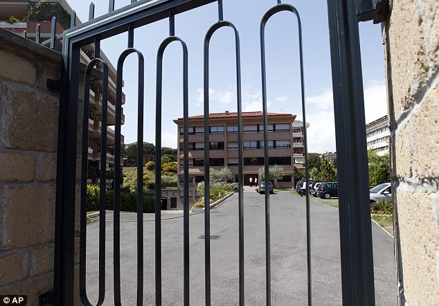 Imposing: The entrance of the Legion of Christ headquarters in Rome seen from behind a gate
