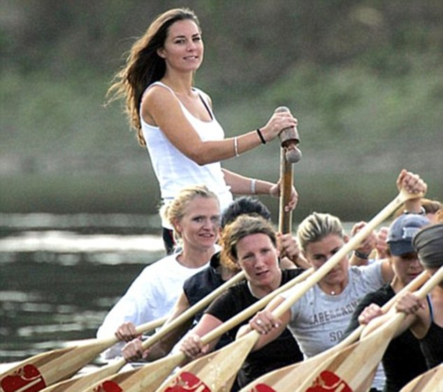 The Duchess of Cambridge (standing) on a dragon boat training session with Miss Sayle, (far left)