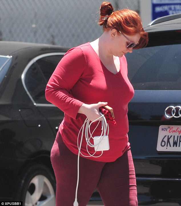 Colour co-ordinated: The Help star wore a red outfit to match her fiery locks