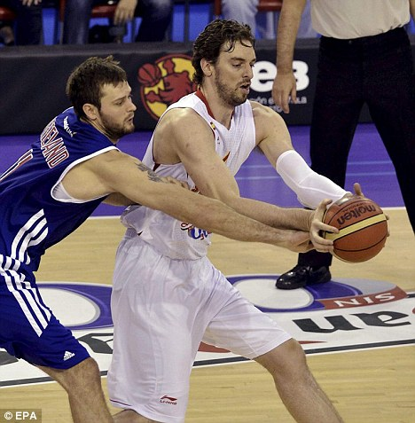 Moving on: Freeland (L, in action for Britain against Spain) will leave Spanish team Malaga for Portland