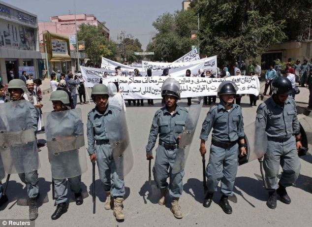 Peaceful protest: The march, from the Afghan Ministry of Women's Affairs to a traffic circle near a U.N. compound, was guarded by a large cordon of Afghan police