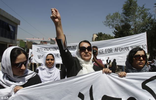 'Death to those who did this': The predominantly female protesters shouted slogans along the march route, calling for justice and an immediate change in laws for greater equality