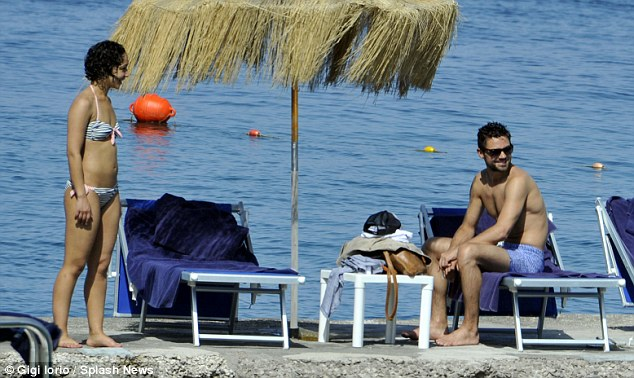 Smitten: The pair seemed to only have eyes for each other as they caught some rays in the Italian sunshine
