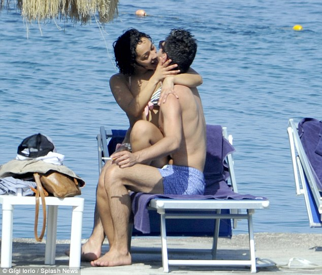 Moving on! Dominic Cooper appears to have finally moved on from Amanda Seyfried as he kisses actress Ruth Negga while on holiday in Italy