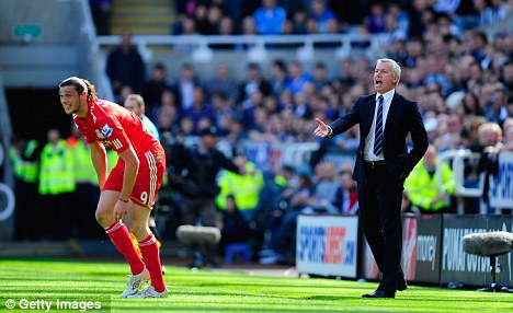 Keen on a return: Alan Pardew (right) would relish the chance to work with Andy Carroll again