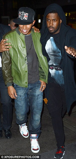 Party time: Lewis was kitted out in his best clubbing gear - cool cap, leather jacket and jeans,  Lewis and J Cole dined at Hakkasan in Mayfair before heading to Funky Buddha and then the May Fair hotel