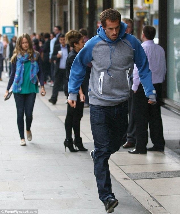 Feeling hungry? Andy dashes ahead as the two make their way towards upmarket food store Wholefoods to pick up lunch