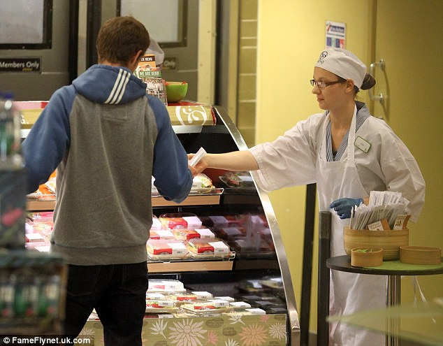 Refuelling: The tennis ace picked up some sushi from the Japanese counter