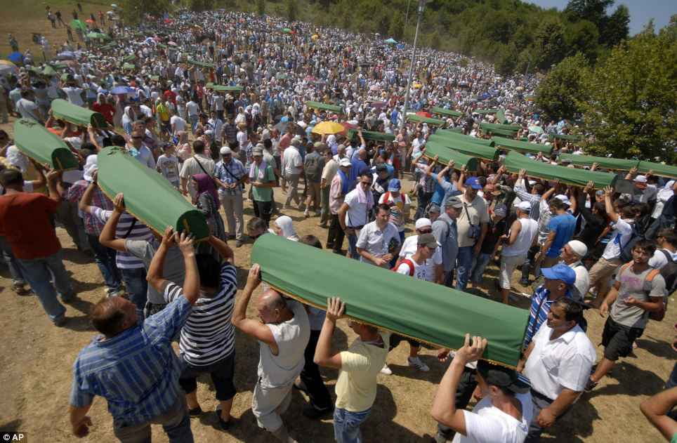 Last honour: The coffins represented only a small number of the thousands of Muslim men and boys slaughtered in July 1995 by Serb forces