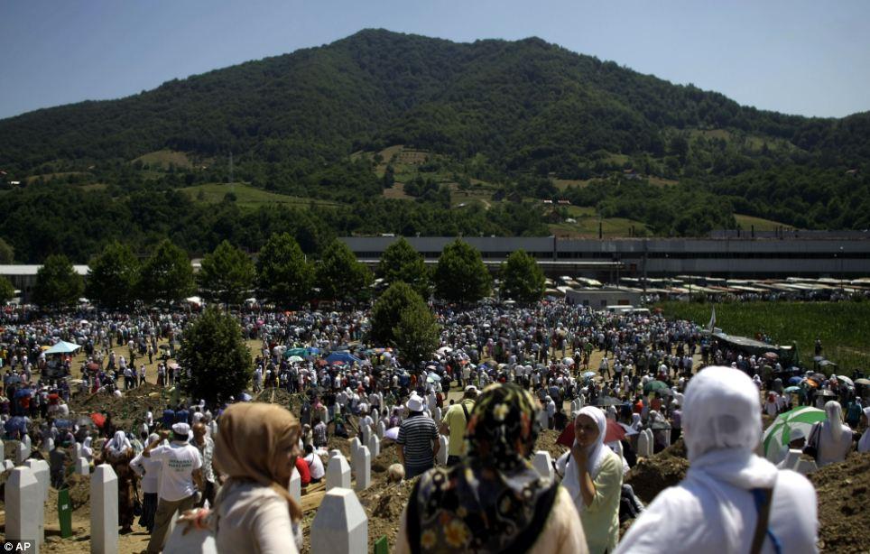 Remembrance: People gather at the Potocari memorial complex near Srebrenica, some 160 kilometers east of Sarajevo, Bosnia and Herzegovina