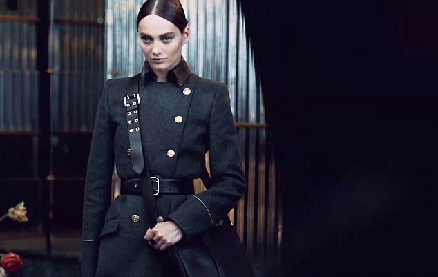 Reserved beauty: Estonia model Karmen Pedaru also features with her military style contrasting with Kate's character's femininity