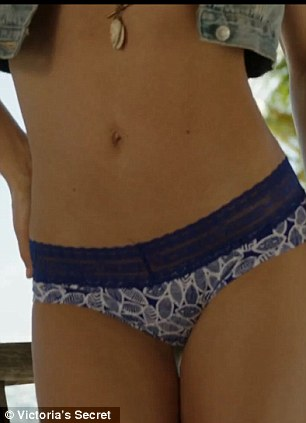 Close up: The brunette beauty showed off her toned physique in the new summer range video