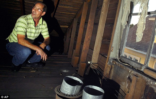 Hidden treasure: This is the soot-covered attic where Karl Kissner discovered the box full of extremely rare baseball cards last February