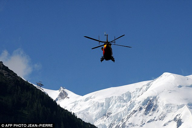 Rescue: A helicopter from the Securite Civile (emergency services) flies over the Mont Blanc massif as investigators look for those stranded in the avalanche