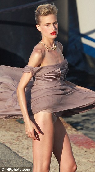 Daring: The wind proved a little too strong as Karolina turned back to the front after showing off her bottom