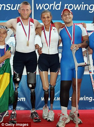 Winner: Oksana Masters, pictured centre, with team mate Robert Jones, pictured left, after winning the 2012 Samsung World Rowing Cup III in Serbia