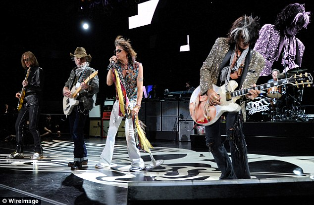 Now for the rock n roll: Tyler and his band are set to release a new album later this year, making it Aerosmith's 15th studio offering, pictured here earlier this month, from left, Tom Hamilton, Brad Whitford, Tyler and Joe Perry