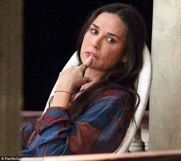 Showing the strain: Demi Moore looked tired and stressed as she took a break on the set of her new movie Very Good Girls in Brooklyn, New York, on Wednesday