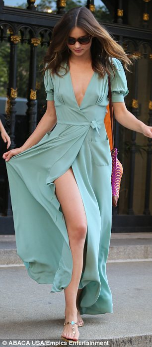 Making us green with envy: Miranda flashed her leg in a flowing mint maxi dress yesterday
