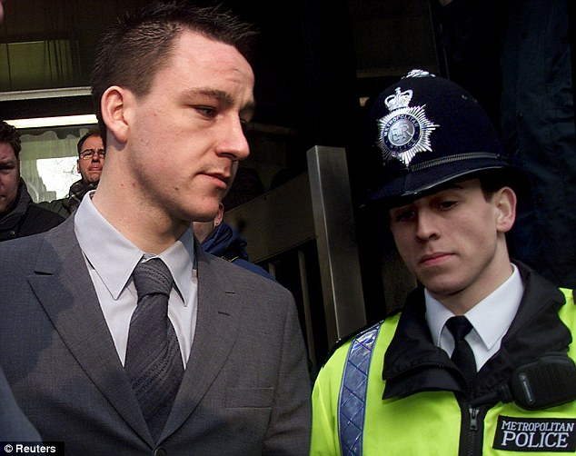 Ugly scenes: John Terry leaves court in 2002 after being accused of attacking a doorman in Kensington, London, who claimed his left eye 'exploded with blood'. He admitted punching him but denied using a bottle
