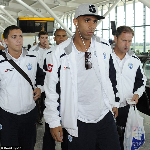 Not present: QPR footballer Anton Ferdinand, pictured leaving Heathrow for a tour of the Far East, was not in court for the verdict