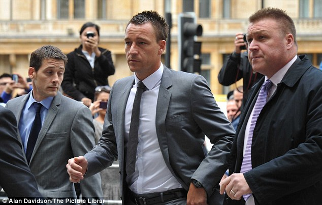 Nervous: The former England captain was escorted by security past a phalanx of press photographers and TV cameras into the court