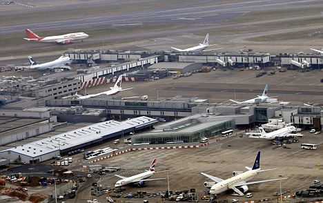 Busy: Heathrow will see an unprecedented number of passengers fly in during the Games but there are fears they won't cope
