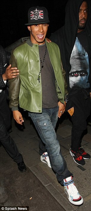 Tale of two cities: Lewis looked the worse for wear as he left club Funky Buddah to continue the party at the May Fair hotel, as girlfriend  Nicole Scherzinger enjoyed a night out with girlfriends at an LA club