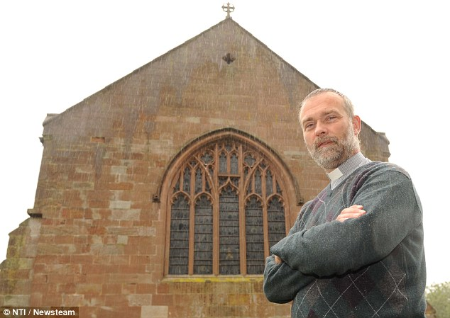 Reverend Michael Last (pictured) is concerned the huge bird's nest could pose a fire risk to the church
