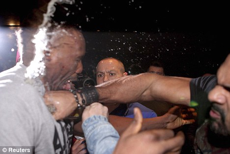 The punch that stated it all: Haye (right) brawled with Chisora in Munich