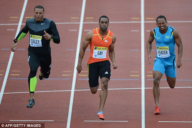 Centre of attention: Gay holds off fellow American Ryan Bailey and Jamaica's Michael Frater to win