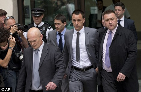 Cleared: John Terry leaves court after being found not guilty on Friday