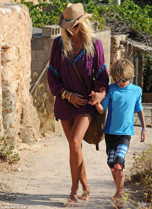 Yummy mummy: The Australian-born model was joined by her little eight-year-old old son Aurelius