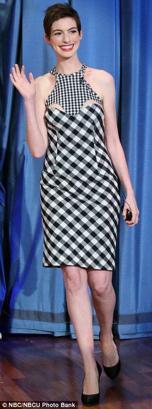 Who's that girl?: Anne Hathaway arrived on Late Night With Jimmy Fallon looking stunning before slipping into fancy dress