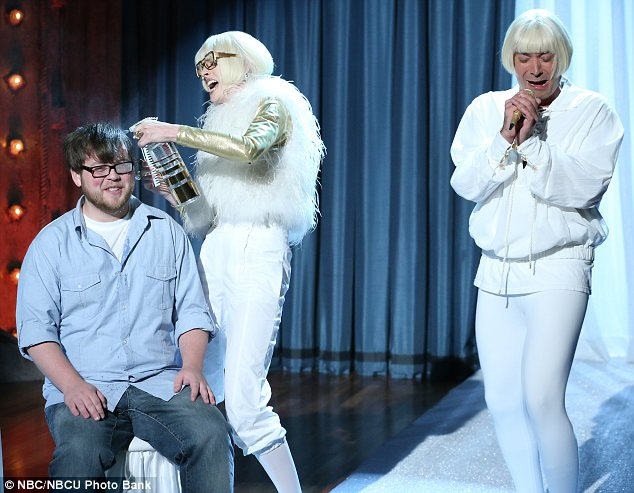 Musical mayhem: Anne and Jimmy both sang in silly voices as Anne also combed a man's hair