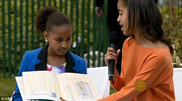 Growing up: The President opened up on what it is like to be a father with two young girls, Sasha, 11, left and Malia, 14, right, who are starting to demand more independence