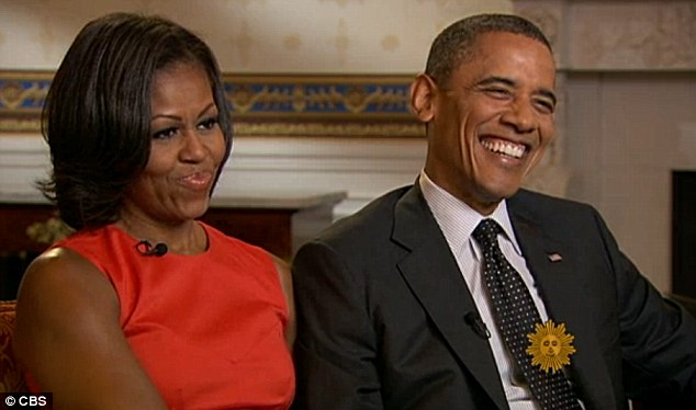 Parents: Barack Obama, pictured with wife Michelle, said he was experiencing 'empty nest syndrome' for the first time now his daughters are going on holidays on their own