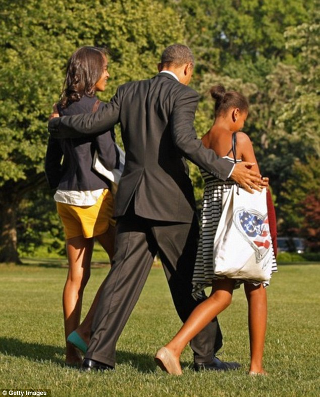 Close: Mr Obama said without his daughters, pictured, around the corridors of the White House will feel lonely
