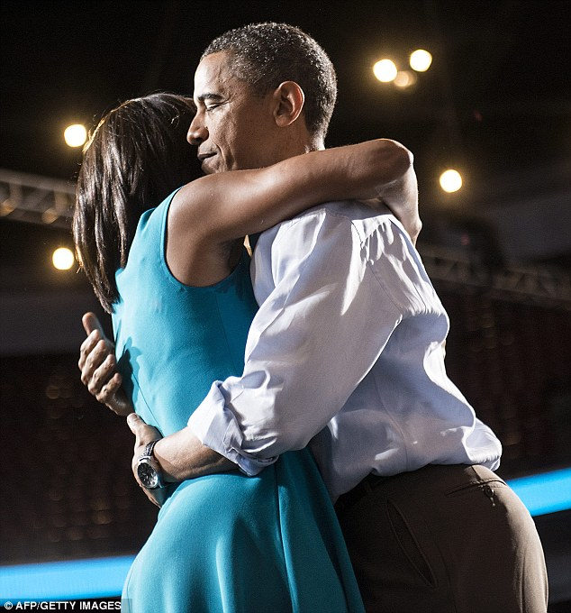 Partners: Mr Obama told CBS being president had actually brought the couple, pictured, closer together
