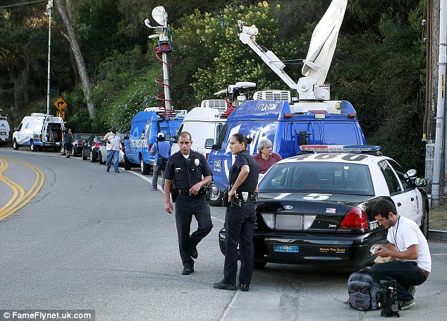 'Recluse': Police and film crews surrounded Sage's Hollywood Hills home yesterday which was said to have been a 'mess'