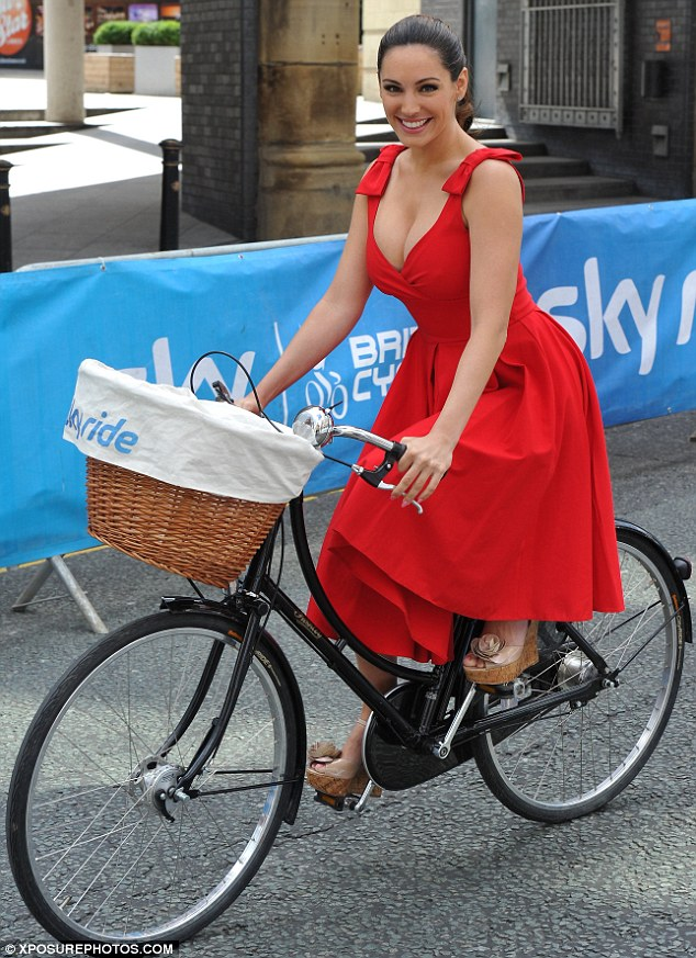 Not your usual exercise gear: Kelly was her usual sultry self in a plunging scarlet dress